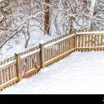 Wooden Backyard Fence Of House With Trees Forest In Neighborhood With Snow Covered Ground During Blizzard White Storm Snowflakes And Small Gate Door Stock Photo Alamy