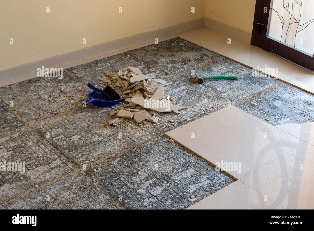 https www alamy com home renovation of ceramic tiles in an entrance way breaking up the tiles diy and cleaning up broken pieces before laying new tiles with mortar and c image333747564 html