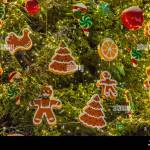 Christmas Tree Decorations Background Garlands Gingerbread Man And Candy Canes Stock Photo Alamy