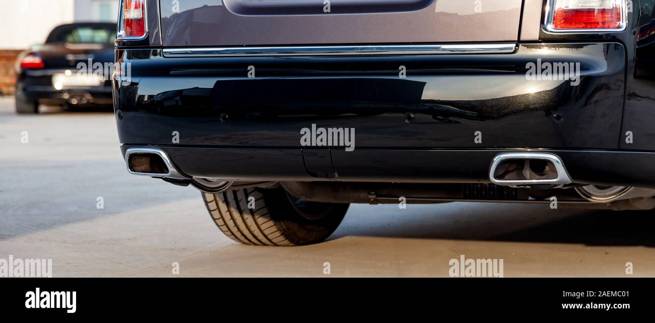 https www alamy com close up of a black luxury car bumper of an sedan with two side turbo exhaust pipes outdoors on asphalt auto service industry air and environment po image336050625 html
