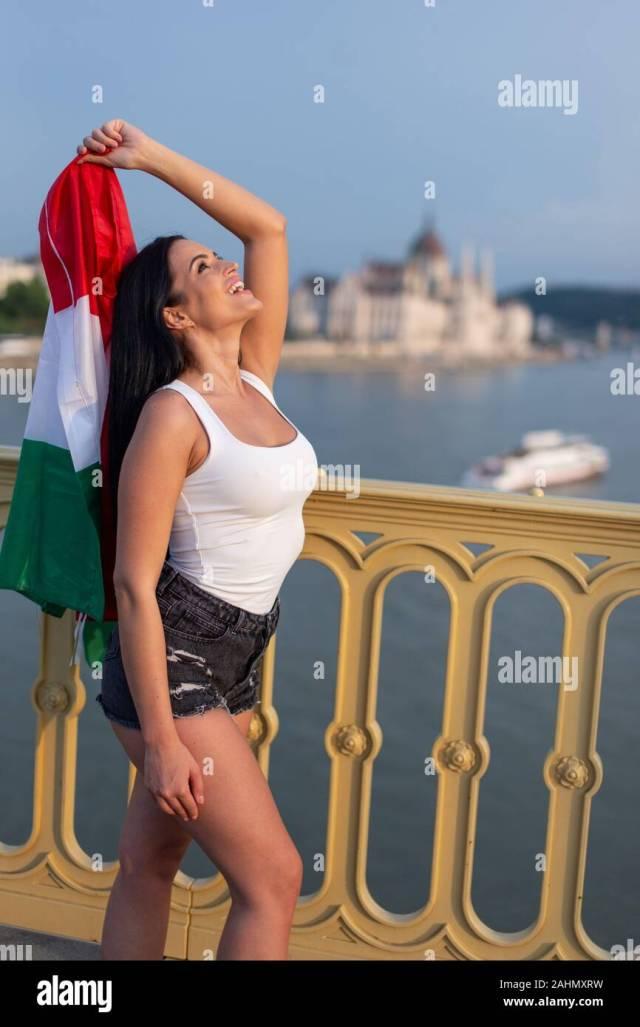 https://i1.wp.com/c8.alamy.com/comp/2AHMXRW/happy-young-woman-holding-hungarian-flag-at-budapest-hungary-2AHMXRW.jpg?w=640&ssl=1