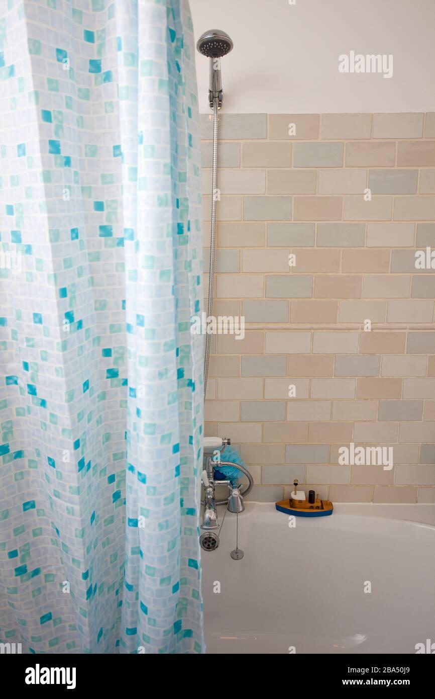 https www alamy com bathroom interior with half open shower curtain image350464193 html