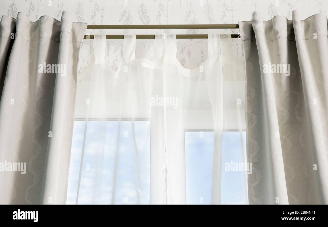https www alamy com double curtain rods for see through day curtain and room darkening night curtains hanging in front of a window with blue sky image355749045 html