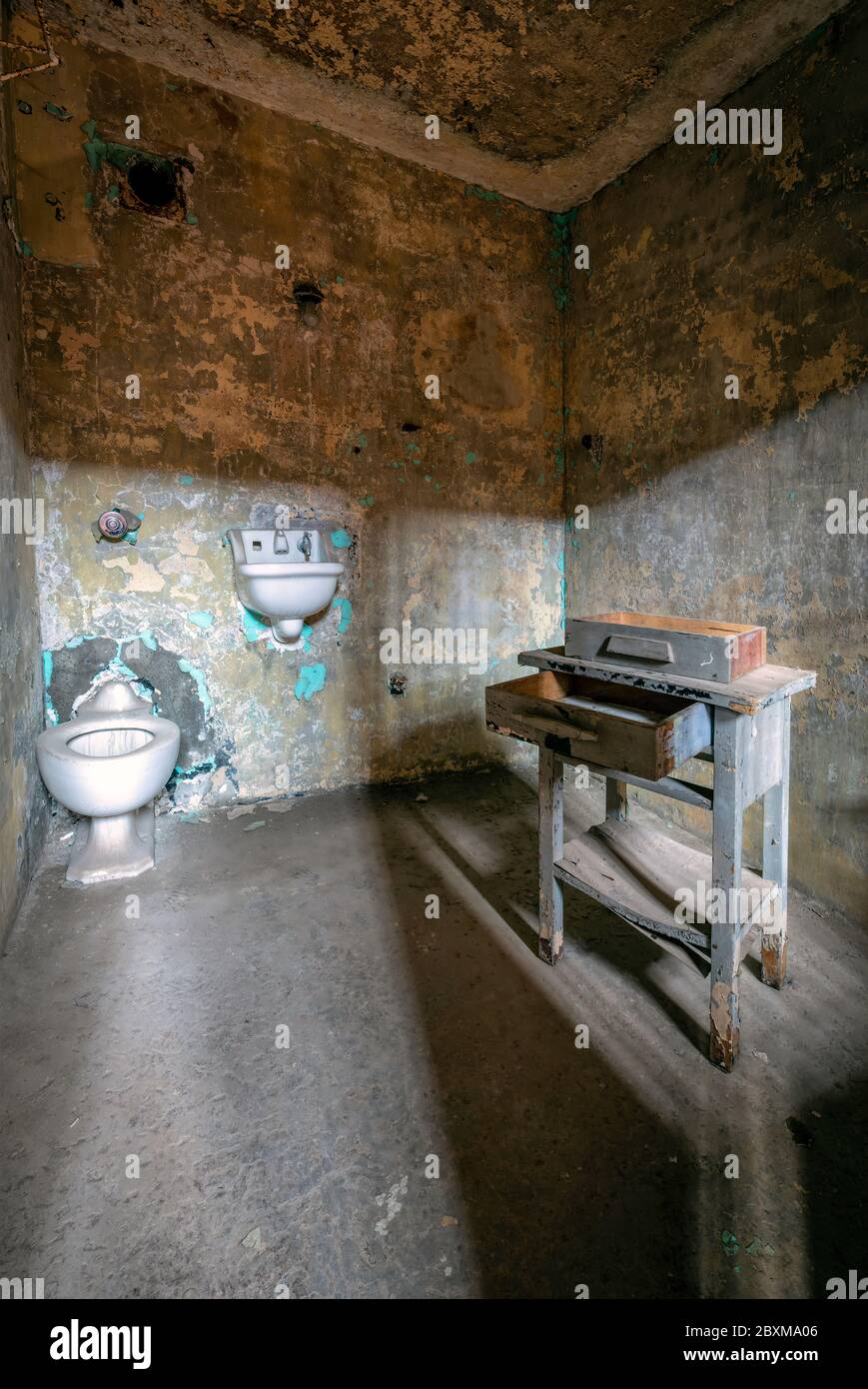 https www alamy com interior of a cell in an abandoned prison with an old toilet sink and desk image360635302 html