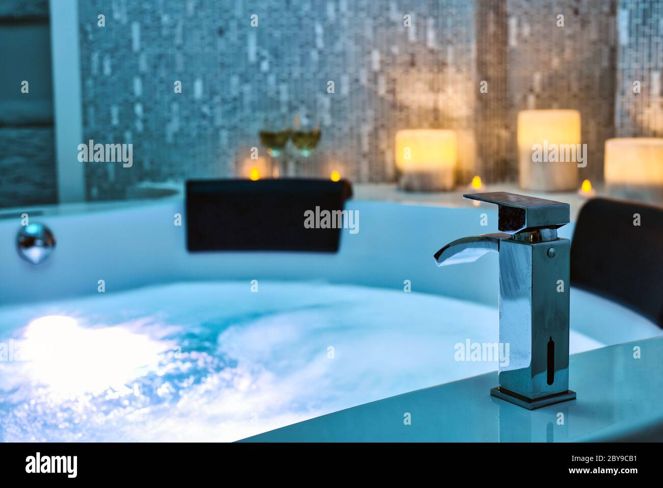 https www alamy com blue bubbling water in spa jacuzzi close up faucet decorated with candles on the background relax and lifestyle abstract background with blue lights image361010357 html