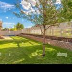 Panorama Frame Home Backyard With Vibrant Lawn And Raised Planting Bed Along White Picket Fence Stock Photo Alamy
