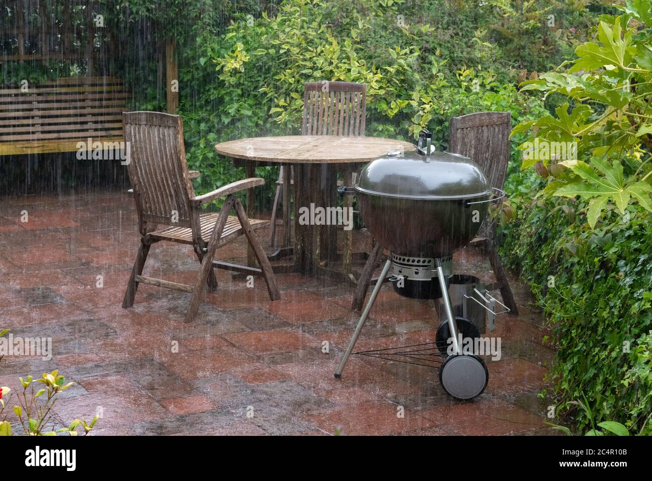 https www alamy com heavy summer rain falling on garden patio furniture and barbeque in june scotland uk image364382043 html