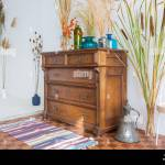 Old Antique Old Mahogany Chest Of Drawers In A Room With Additional Decor Stock Photo Alamy
