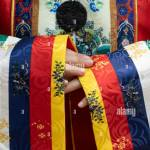 Close Up Of Hands Sleeves And Intricate Patterns Of Vietnamese Traditional Royal Silk Robes With Colors Yellow Blue Red And White Worn By Queen Stock Photo Alamy