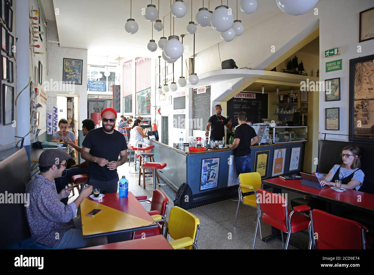 https www alamy com morocco tangier tetouan region tangier young tangierois connected in the cafe art deco of the rif cinema image369617000 html