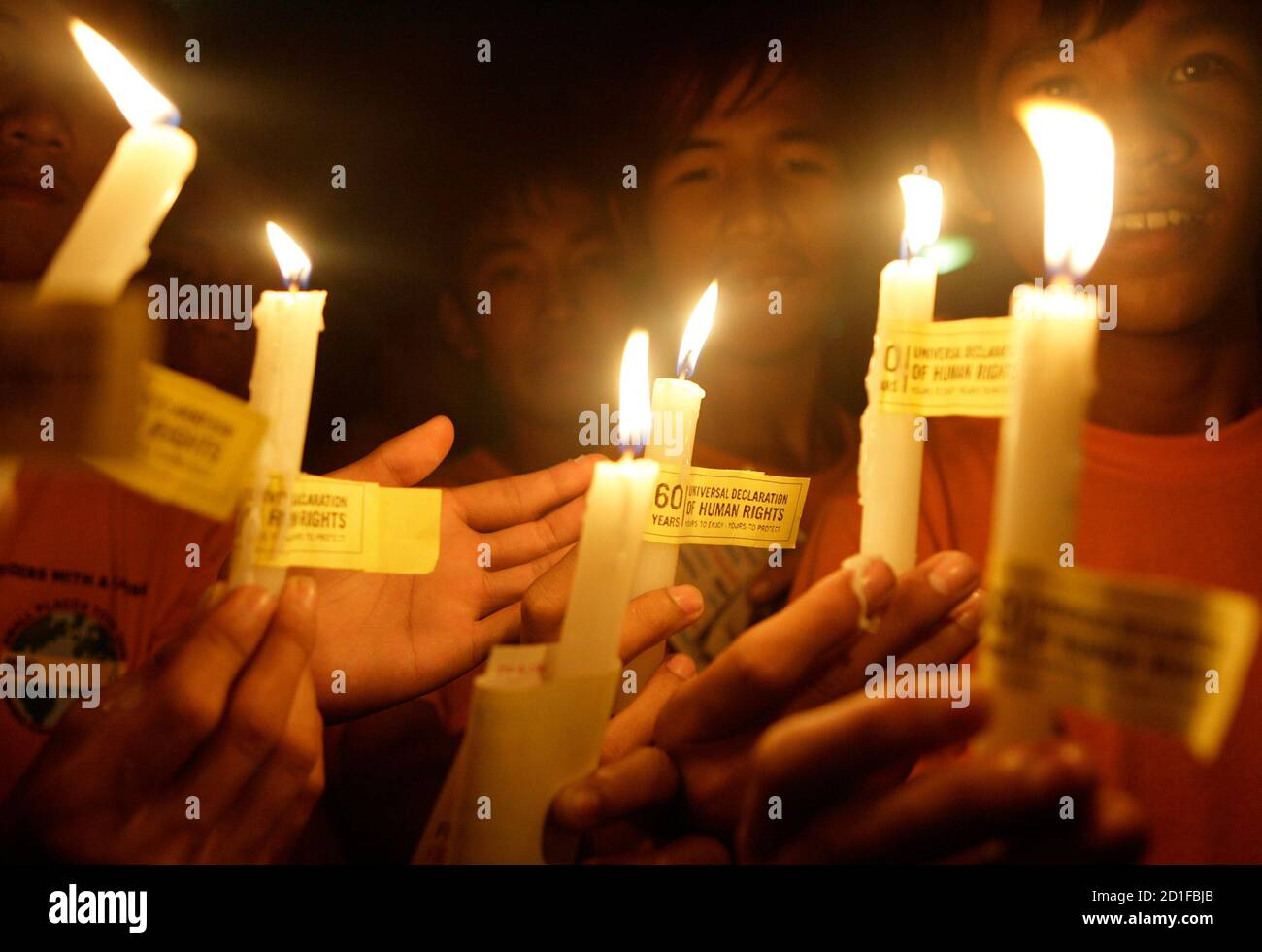 https www alamy com youths hold candles during a candle lighting ceremony to mark the 60th anniversary of the universal declaration of human rights in manila december 10 2008 reuterscheryl ravelo philippines image379581171 html