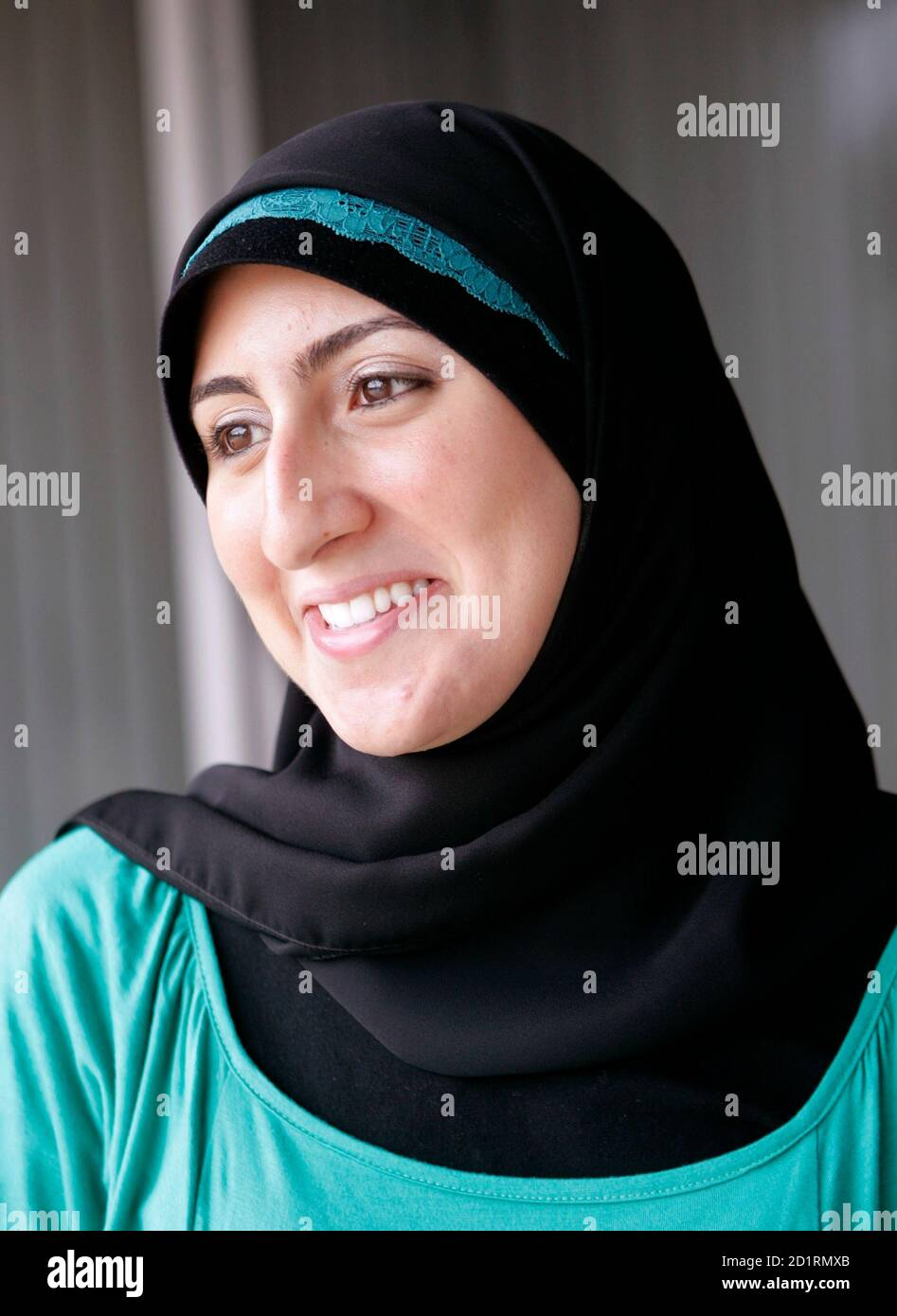 With a hijab on her head. Zahra Huber 23 Wears Her Muslim Hijab While Working At A Radio Station In Southfield Michigan August 20 2007 Huber Does Editing And Research At The Station And Says That She Aspires