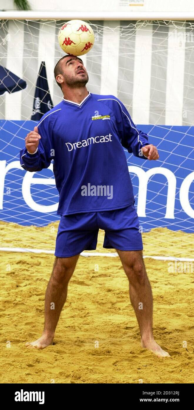 Eric cantona is one of the most flamboyant players ever in football and his antics off the field. Former Manchester United Football Player Eric Cantona Balances A Ball On His Head During Training In The Sand At Richmond For The Inaugural Dreamcast Beach Football Challenge To Be Held On 15 07 00