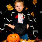 Surprised Young Boy Costume Dressed As A Halloween Cosplay Of Scary Dacula A Jack O Pumpkin Lantern On Black Yellow Leaves Background Studio Shot Stock Photo Alamy