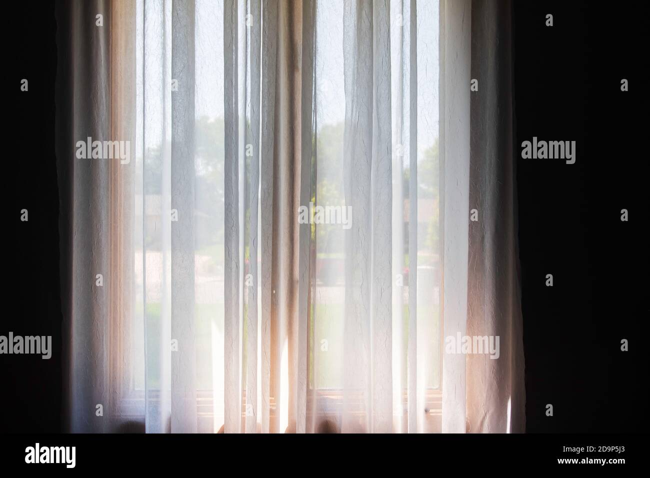 https www alamy com white semi sheer curtains hanging from a decorative curtain rod on tall double windows image384647371 html