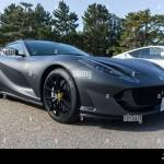 Front View Of A Matte Black Ferrari 812 Superfast With 20 Inch Forged Black Racing Wheels Outside In A Park In Sunshine Stock Photo Alamy