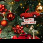 Close Up View Of Colorful Christmas Decorations Hanging On Christmas Tree At Eve Of Winter Holidays Stock Photo Alamy