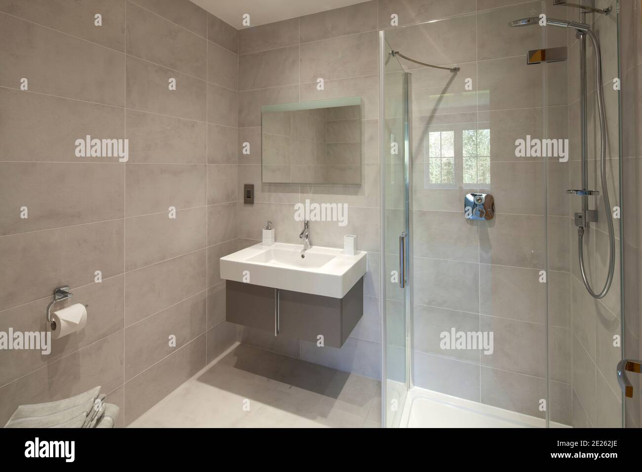 https www alamy com contemporary shower room or bathroom with grey wall tiles white basin and glass shower cubicle image397201574 html