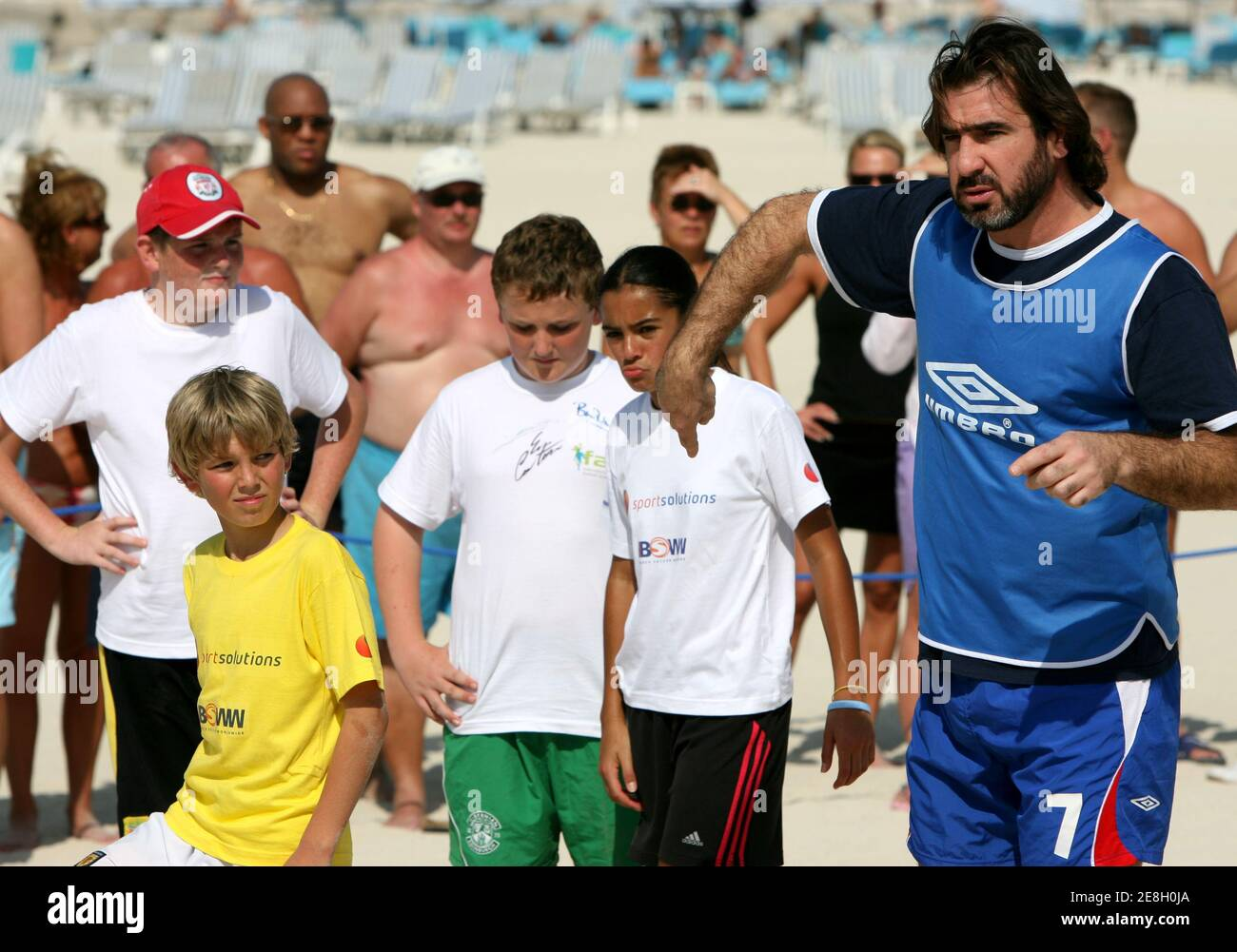 Kids', toddler, & baby clothes with eric cantona designs sold by independent artists. Former Manchester United Forward And Beach Soccer Ambassador Eric Cantona Coaches Children During A Soccerex Exhibition On A Dubai Beach November 13 2005 Soccerex Is A Soccer Festival Held On The Business