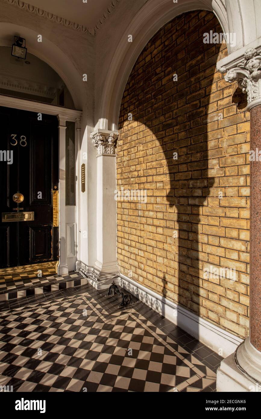 https www alamy com ornate entrance to mansion block of flats in kensington london decorative arches brick wall deep shadows and chequered tiles image403582570 html