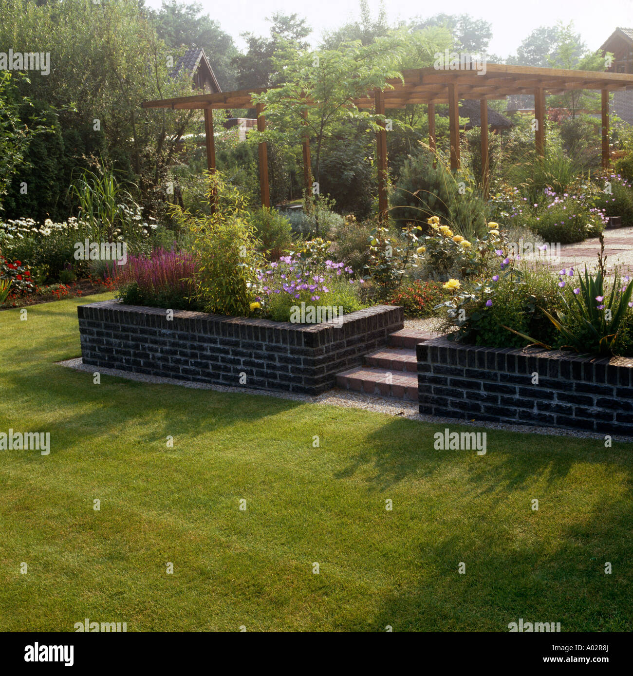https www alamy com lawn in front of steps to patio with raised beds and pergola in country image9861137 html