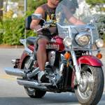 Man Riding A Harley Davidson Motorcycle On The Roads Not Wearing A Stock Photo Alamy