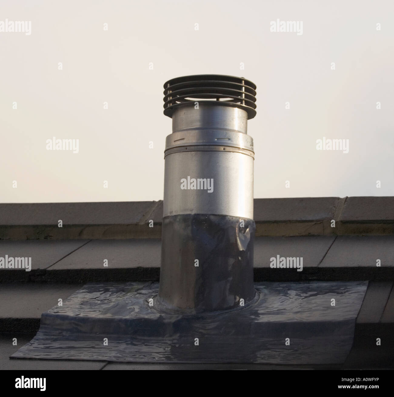 https www alamy com stock photo chimney flue on a roof metal pipe roof tiles lead flashing uk 10075065 html