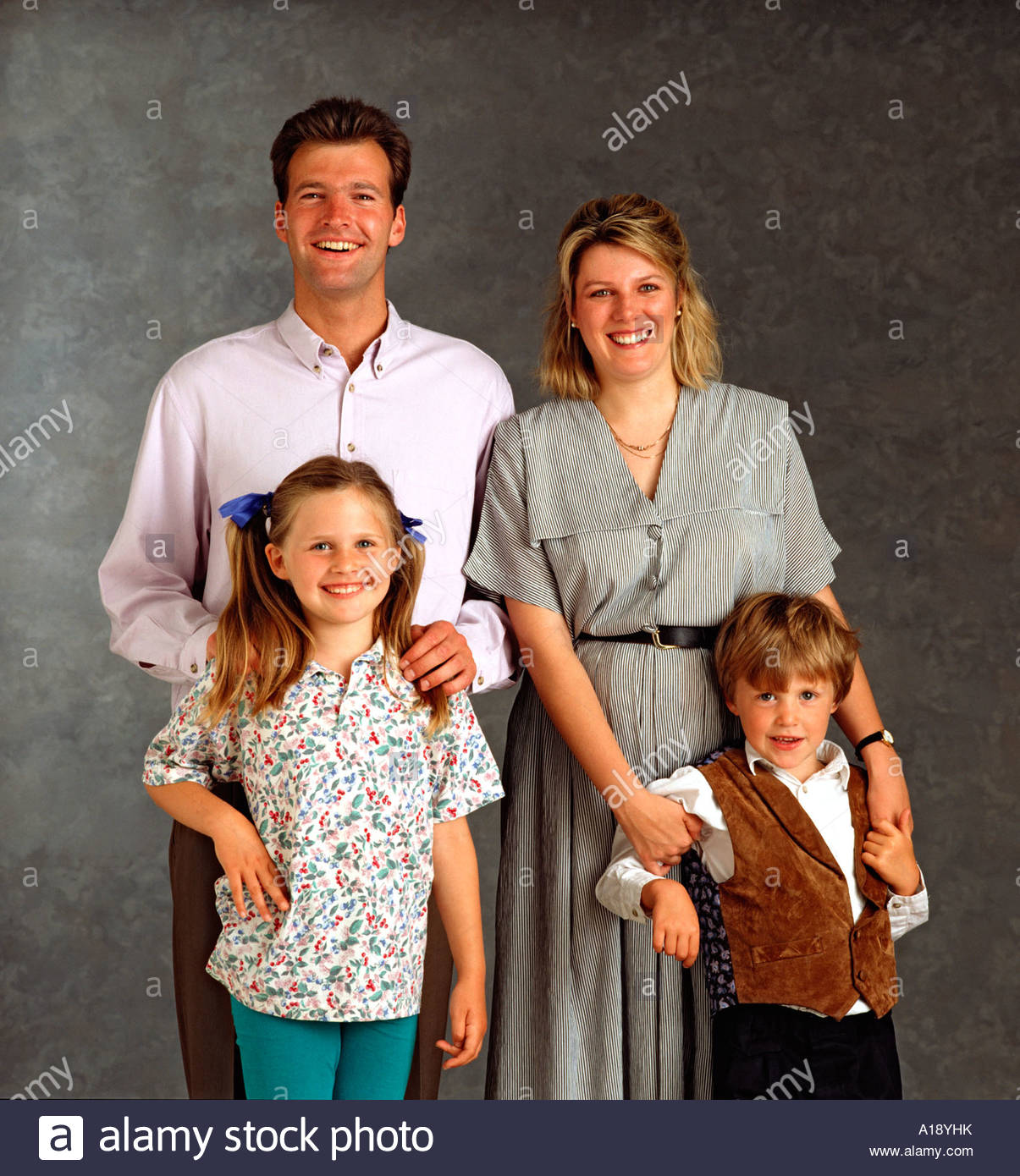 White Middle Class Nuclear Family Posing For Studio Photo