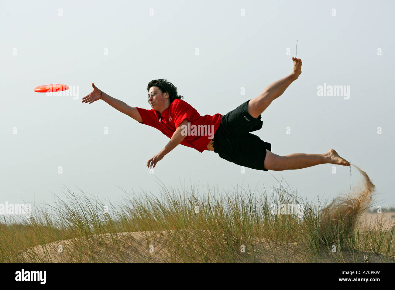 Man In Mid Air Takes Part In Extreme Sport Of Ultimate