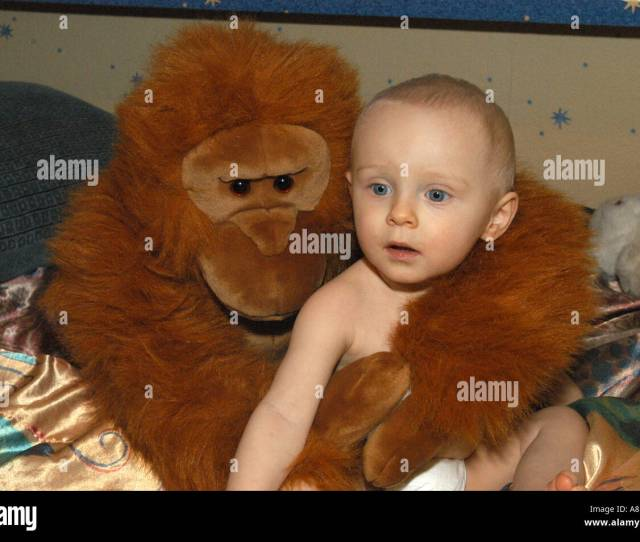Nacked One Year Old Male Child With Toy Monkey Stock Image