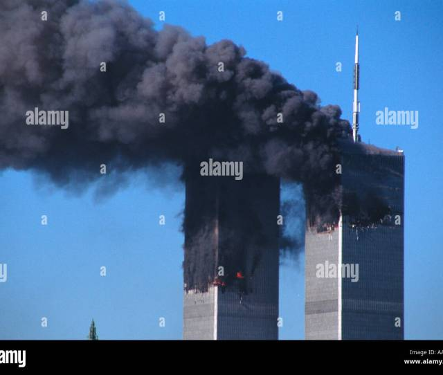 The World Trade Center Standing With Two Gaping Holes Burning Shortly After Each Building Had Been Hit By And Airliner