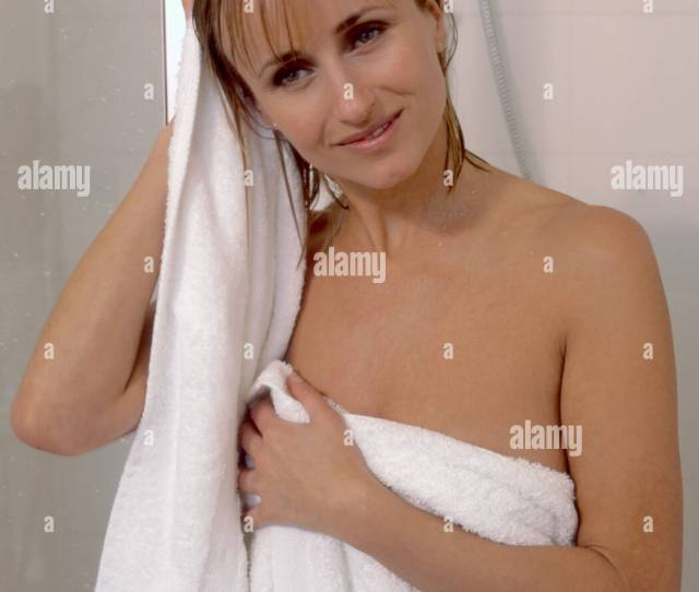 Blonde Woman Wearing White Towel Drying Hair Having Just Had A Shower London