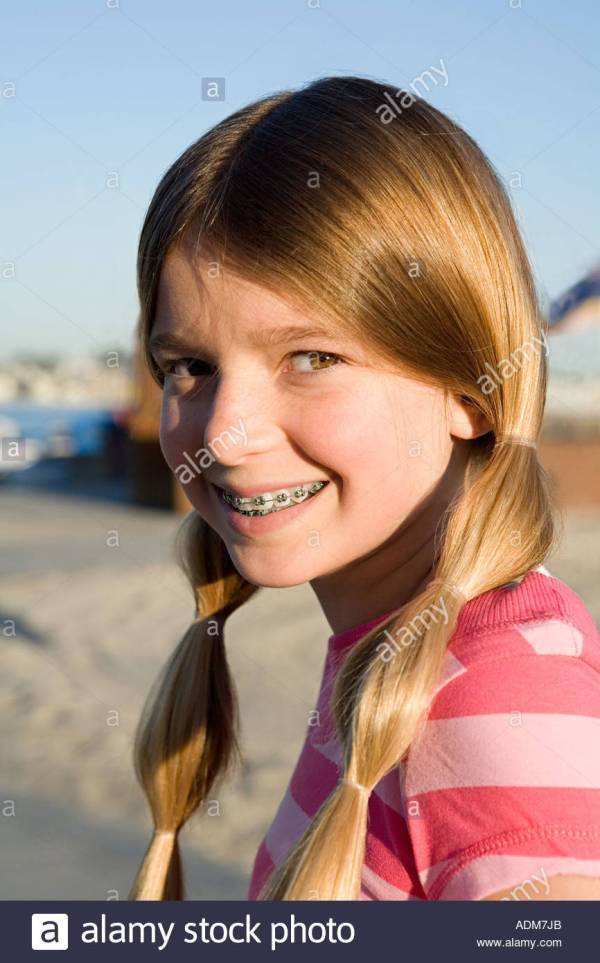 Girl with pigtails and braces Stock Photo 7685482 Alamy