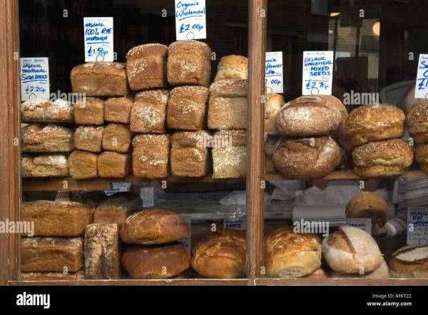 Bakery shop window with freshly baked organic bread for