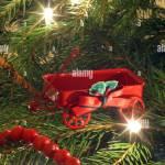 Red Wagon Ornament On Christmas Tree Stock Photo Alamy