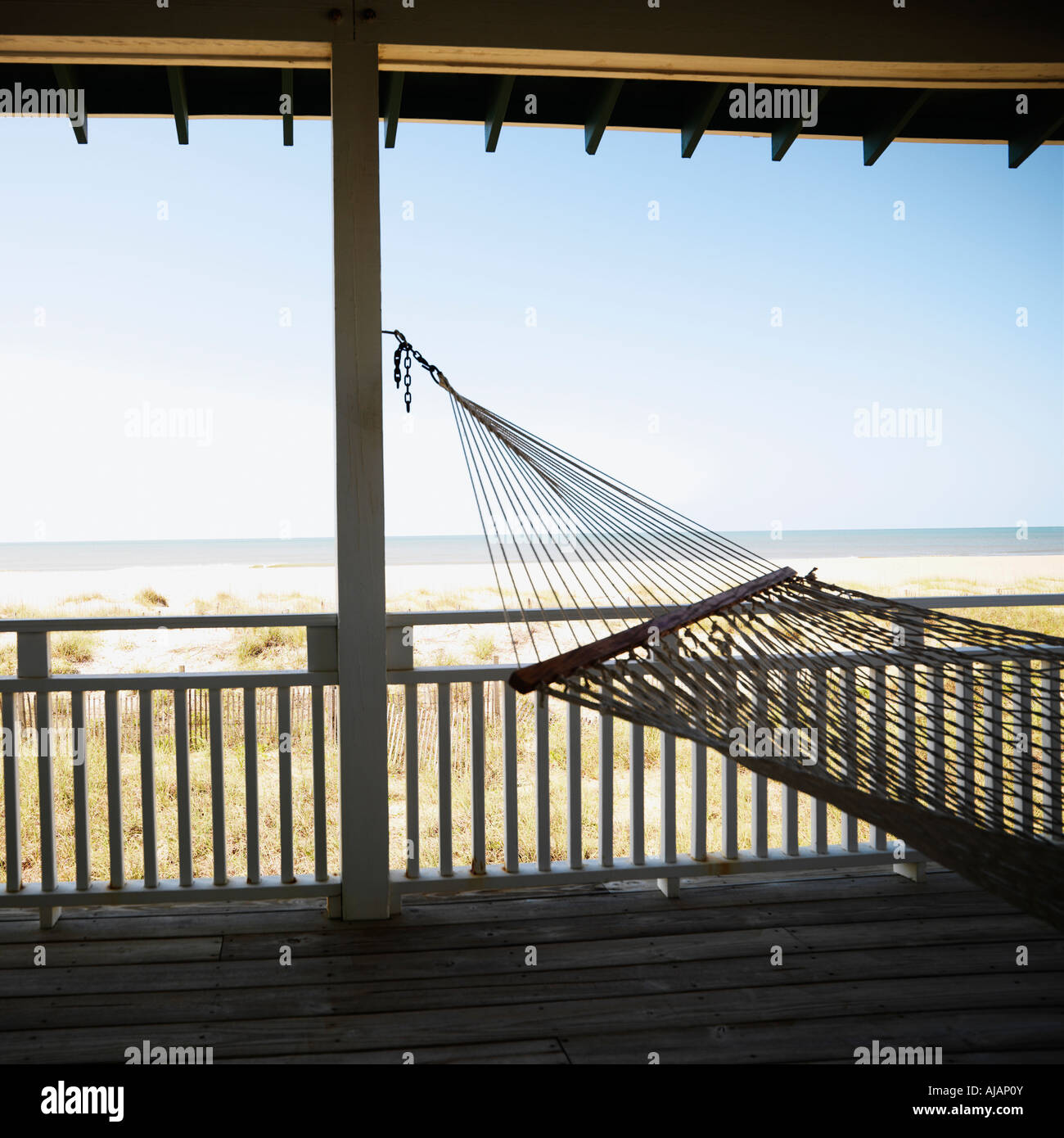View Of Beach From Porch With Railing And Hammock At Bald