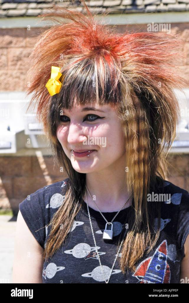 teenage girl with a punk rock hair style and lip ring stock
