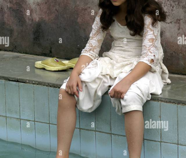 Young Indian Girl Sitting By Hot Spring Pool In Vashisht Bathing Bare Feet In Water India