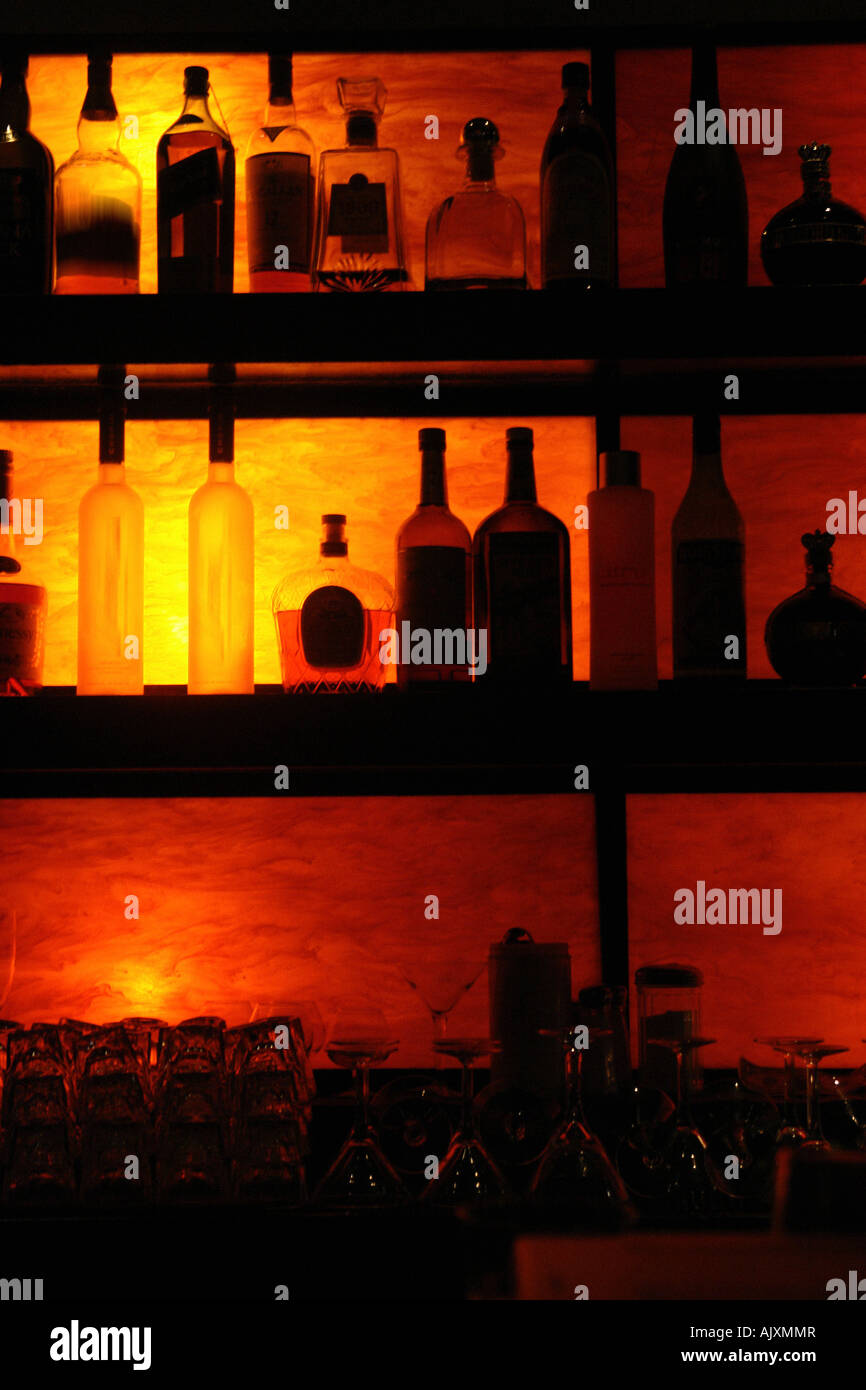 Silhouette Of Back Lit Bottles Of Liquor On Shelves With