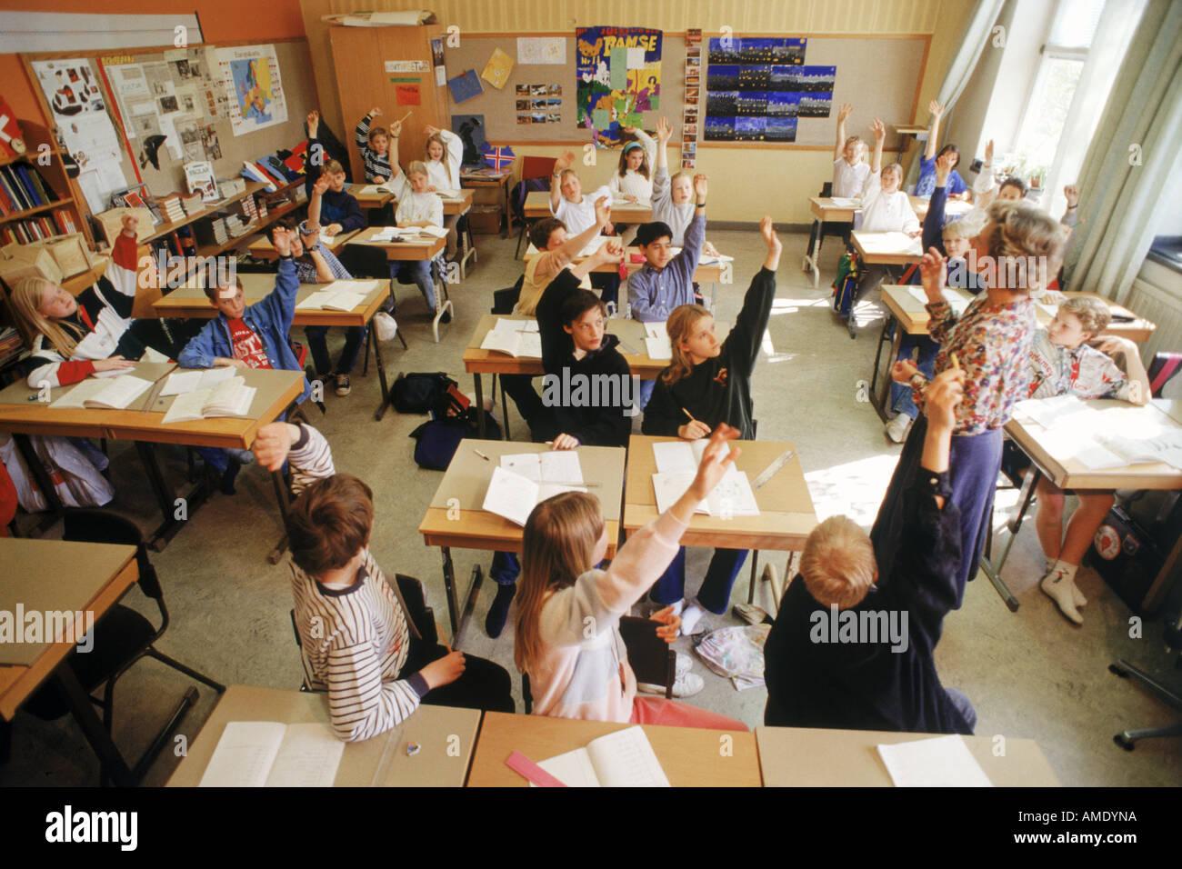 Elementary School Children Sitting At Individual Desks In Swedish Stock Photo