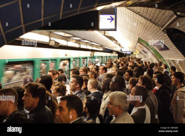 A crowded metro station, Paris, France Stock Photo ...