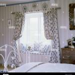 Brass Bed And Swagged Curtains In A Bedroom In An English Country Stock Photo Alamy