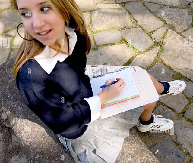 Teenage Blonde Schoolgirl Studying In The Park And Turning Back Smiling
