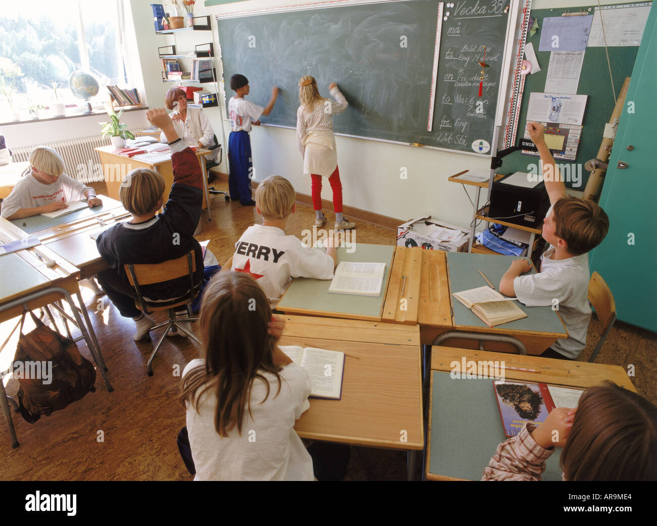 Students In 5th Grade Swedish Classroom Writing On Blackboard During Stock Photo Royalty Free