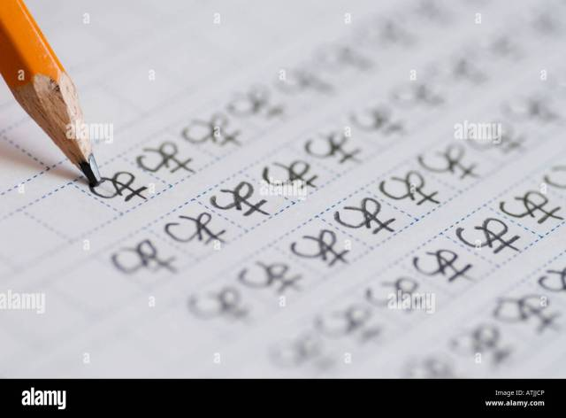 Foreign student learning to write Japanese hiragana characters by