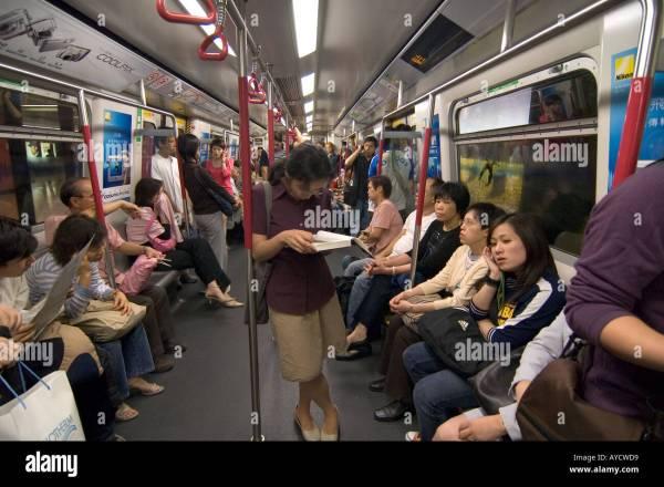 A crowded subway carriage on the Hong Kong metro MTR, Hong ...