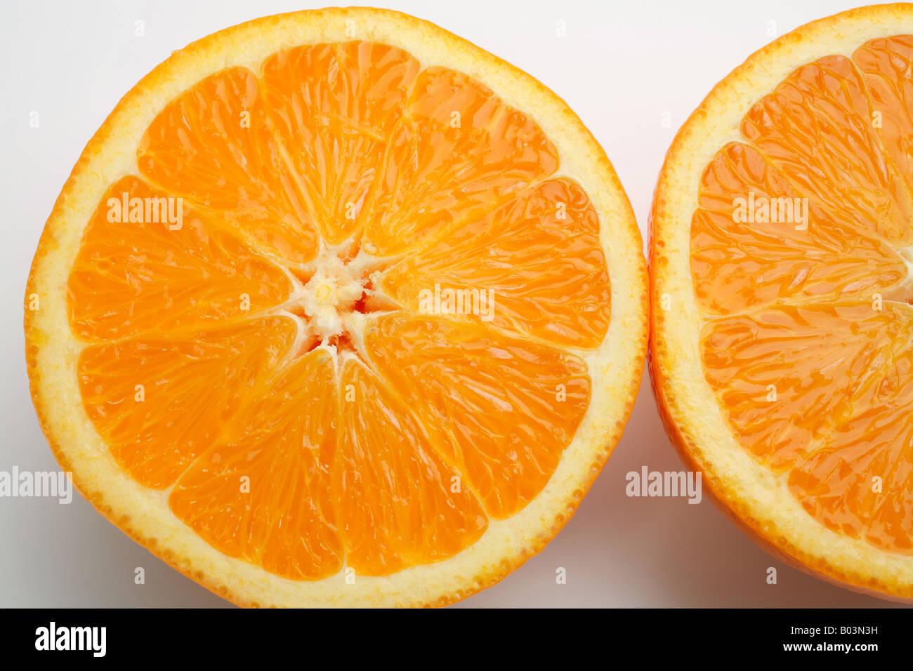 An Orange Cut In Half Showing One And A Half Orange Slices