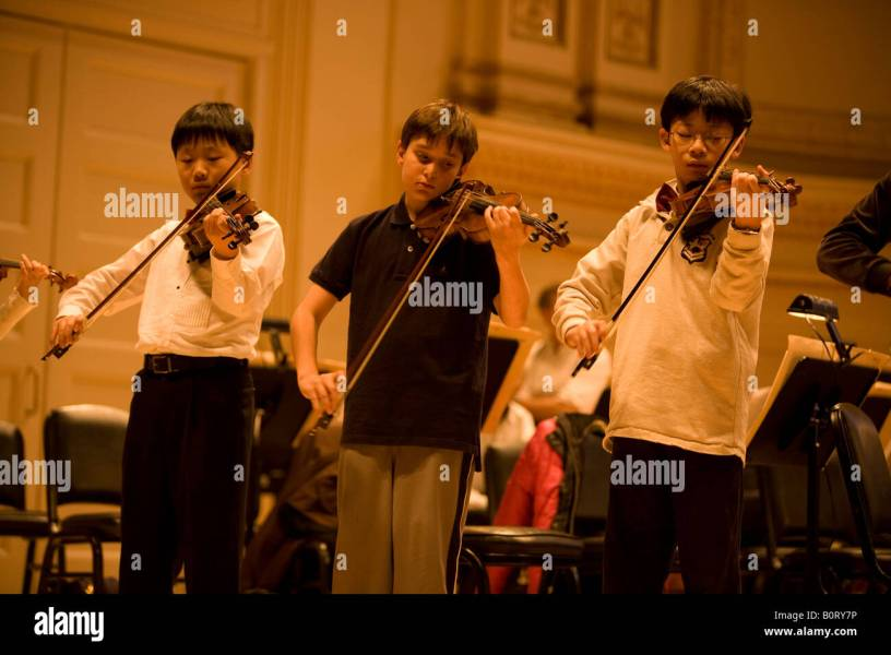 Children Violin Child Musicians Stock Photos   Children Violin Child     Members of the Suzuki Strings of Long Island who range from 3 to 17 years  old