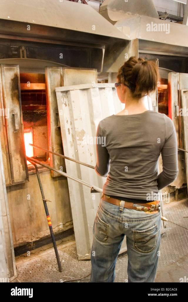 Woman Heating Up Glass In Furnace Glory Hole 60769 Dartington Glass