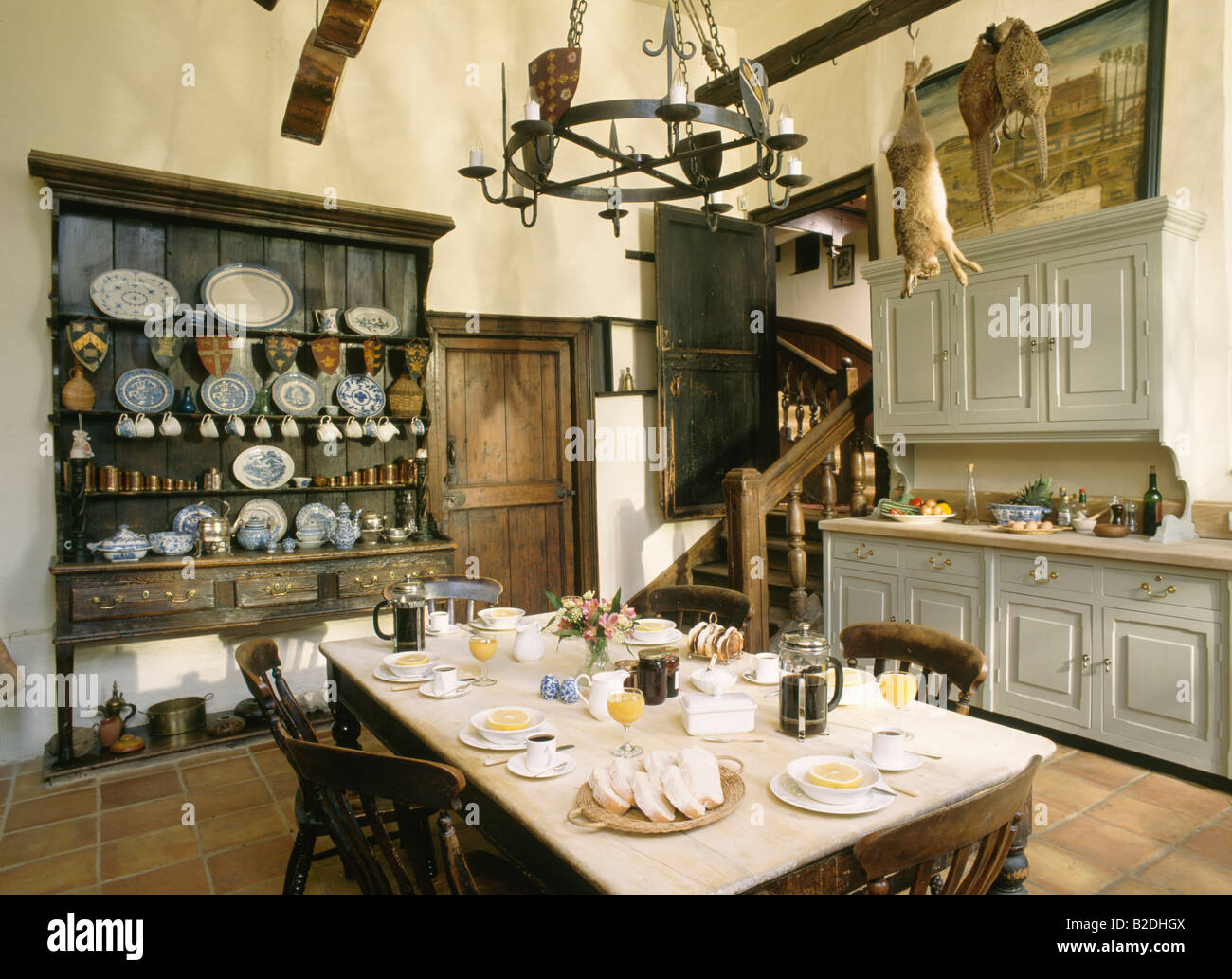 Table Set For Breakfast In Large Old Fashioned Kitchen